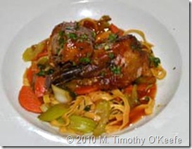 asian style rotisserie of duck w sweet & sour sauce on stir-fried vegetables w soy-splashed fried egg noodles
